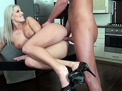 After stripping off her short shorts and tank top, Blanche Bradburry, a blonde Euro-babe is fucked doggy style to orgasm in the kitchen.