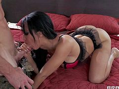 Horny and hot brunette Isis Love in her lace black lingerie enjoys in giving her turned on soldier Johnny Sins a hot blowjob and a cock riding on the bed