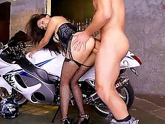 Vicki Chase looks outstanding on that bike. Imagine all those horsepower between those thighs, her soft, warm pussy pressing against the seat, her heavy tits stands proudly on her chest, with rock nipples hard from the cold breathe. This very fantasy turns Johnny Castle on enough to bang the sexy brunette hard, right in front of our prying eyes.