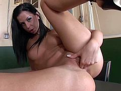 Dirty dark haired and slim babe Larissa Dee gets alone for some time in the interrogation room and uses that to play with her shaved pussy on the desk and pleases herself good