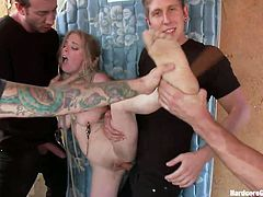 Blonde bitch Penny with pretty face gets gang banged by her five horny boyfriends. She is totally dominated with her tits and legs tied up. They take her to a room and play hard with her nipples and shaved tight pussy. They have so many big toys for her! Their cocks are very hard now and they are riding the cunt!