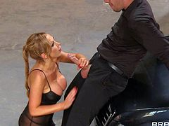 Nikki Benz is a gorgeous woman with huge boobs. Hot bodied lady in stockings and boots gives head to horny man beside a car then takes his love torpedo in her hot box. Watch buxom lady Nikki Benz get slammed.