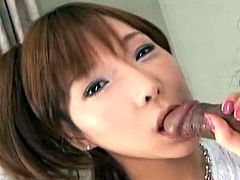 Sweet sexy Asian babe is sucking a dick instead of candy