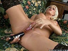 Cute blonde Biancka wearing blck stockings is having some good time in the living room. She pleases herself with fingering and then enjoys toying her sweet pussy.