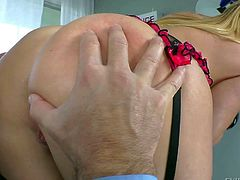 This mature fella John Strong gets his hands on a gorgeous blonde girl with an arousing big ass in her sexy black garter belt and enjoys in licking her good in the kitchen.
