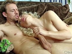 Cute blonde Lily Labeau takes off her bra after getting her neat pussy tongue fucked by her sex partner. Then totally naked chick with natural tits sucks his cock deep. She gives head and plays with her twat at the same time.
