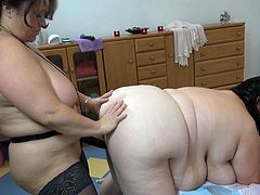 Vera and her girlfriend are two big ladies but their lust is bigger! The brunette grannies have a black strap on dildo and they are using it a lot. The big one bends over and offers her huge saggy ass for fucking. Her partner begins penetrating her hard and deep, making those huge boobs and belly bounce