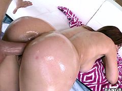 This bitch will suck on that dick and then she gets her ass all covered in oil so you can watch it shine while she takes a banging!