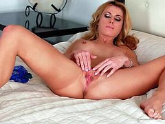 Randy Moore is a beautiful hot-bodied adult model. Babe in black lace panties and bra bares her big boobs before she gievs a close-up view of her pink love hole. Watch Randy Moore play with her snatch in the bedroom.