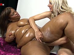 Watch this sexy blonde and a BBBW have a great time in a lesbian clip where they please one another with some great fisting.