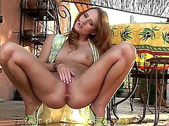 Mesmerizing redhead bombshell Denisa Heaven posing naked in the garden