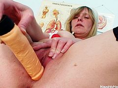 Ugly mature nurse Agnesa plays with a dildo in the office of the doctor