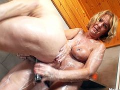 Horny and slutty European mom Halina sprays whipped cream on her girlfriend's flabby boobies and licks it off. Sexy mom also bangs her GF with a dildo.