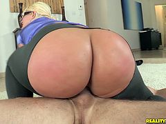 This big ass blonde shakes her ass cheeks as she rides this guy's cock. Then, she gets on her knees to suck it better.