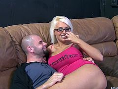 Nerdy and daring blonde babe with glasses is here to suck his massive dick indoors