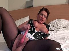 Kinky mature in pantyhose teasing her horny cunt with a dildo