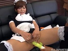 Adorable Japanese housemaid sits on a sofa showing her beauties and fingering her pussy. After that some guy comes up to her and starts to toy her vagina.