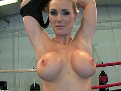 Pretty dark-haired chick Tanya Tate is getting naughty on a ring. She strips, fondles her nice body and then pleases herself with fingering.