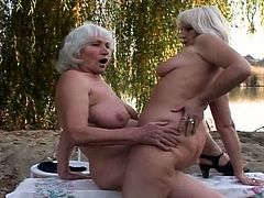 These grannies will keep you glued to the screen as they get buck naked and engage in nasty lesbian sex! They touch each eather and get super nasty outdoors!
