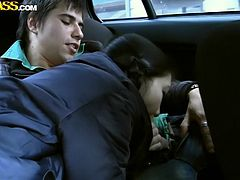 Horny slut gives dirty blowjob in the car to guy with large dick