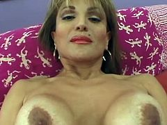 After I fed my cougar with my big, thick dong she laid on her back on that couch and spread her legs and pussy lips. She gave me an awesome head and those big lips slide on my penis just the way I thought it will be. The horny bitch then spread her pussy lips eager to receive my dick inside her hairy cunt