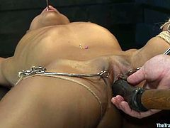 Slim and hot Black girl gets tied up and gagged. After that she gets her tight pussy stuffed deep with big dildo and a fucking machine