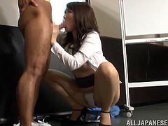 Slim Asian babe stands on her knees and gives hot blowjob. After that she gets fucked nice and deep in a conference hall.