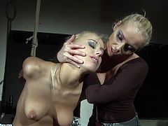 Blonde lesbians Kathia Nobili and Nikky Thorne are playing dirty games in a basement. Kathia ties Nikky up and then pounds her sweet pussy with a dildo.