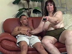 This big fat bitch is lazy as fuck just laying on the couch eating junk food and potato chips. Her man comes along and shoves more chips. Then he shoves his cock in her mouth and between her legs.