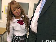 This filthy and naughty Japanese babe gets down on her teachers hard dick and starts sucking it. The cum in her mouth shows how bad she needs a good grade.