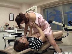 Hot Japanese doctor seduces her patient and makes him make love with her. She sucks his dick passionately and then lets him drill her juicy coochie from behind.