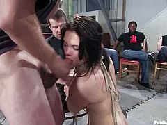Cute dark-haired girl Raina Verene is having fun with a few dudes indoors. The men tie her up, play with her body and then poke their pricks into her mouth and pussy.