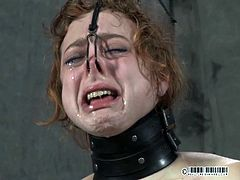 This domme tortures her slave by tying her to the chair and watching her squirm. Her tits are bound and squished flat by the pressure of the rope around them. Her tits are slapped and her pussy is fingered.