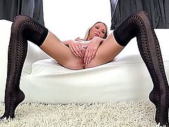 Gorgeous babe Olli  giving the dirty look and feeling very horny and naughty today is doing some good masturbation of her wet and juicy pussy and licking her feet while wearing stockings.