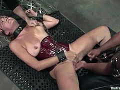 Big-breasted milf Sabrina Fox is getting naughty with horny dude Lobo in a basement. Lobo ties Sabrina up and pokes his hard cock into her pussy and asshole.