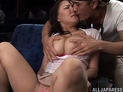 Chubby Japanese slut is getting naughty with some guy in a bus. First, she sucks his prick reluctantly and then rubs the cock against her big natural boobs.