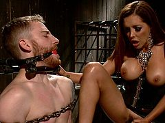 Before he let him fuck her, this busty dominatrix slut tied up her slave and drove her heels deep into his cock and balls. That does look painful.