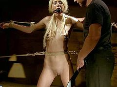 Sweet teenage slave girl Blanche with blond hair, small tits and tight pussy gets ball gagged and punihsed by kinky master in the dungeon. He loves teen girls helpless tight body.