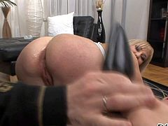 Lovely Russian blonde in white stockings in shoes gets her flexy asshole attacked by dildo from behind. Then two men bang sexy chick at both ends. Watch her get shared on her knees.