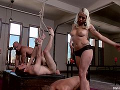 This mature bitch has experience in the BDSM area. She does what she does best, which is make these guys feel a lot of pain and some pleasure.