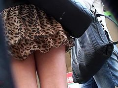 Voyeur manages to film this beauty under her skirt and reveal her naughty panties