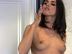 Unbelievably hot brunette Tori Black toys her pussy in the kitchen