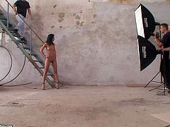 Attractive seductive hottie Shalina Divine with delicious ass and long black hair poses at photo shoot in abandoned building and gives head to photographer with meaty knob in close up