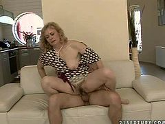 Mature blonde whore with big juicy knockers and pale skin in high heels and provocative summer dress gets fingered by her tanned neighbor with back tattoo and rides on his cock like crazy