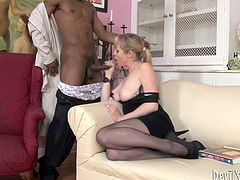 Steamy blond in seductive lingerie and stockings milf sits on the couch with her legs spread wide while a kinky black daddy finger fucks her wet pussy before she inclines to mouth fuck his dick.