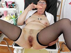 Ugly brunette granny with oversized baggy tits gets on a gynecological chair in order to please herself with intensive finger fuck of her disgusting pussy. Later she starts pouding it with dildo.