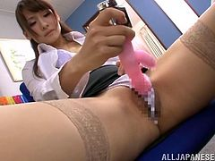 Slutty Japanese teacher Reo Saionji is having some fun after classes. She sits down on a chair and pleases herself with passionate fingering.
