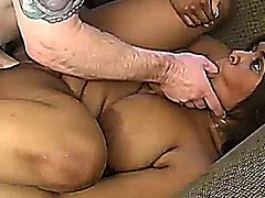 Sexy ebony plumper with lovely big tits enjoys a hardcore interacial fuck session and a sticky facial cumshot