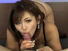 Hell seductive woman Mai Kuroki wearing tempting black lingerie is looking devilish sexy. She is playing with hard stick hugging it with her mouth lips tight. Arousing sex video made by Jav HD.