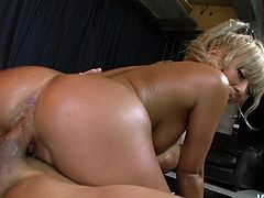 She blows her lover's dick and takes a long ride on his shaft. Then he fucks her oiled up pussy hard in missionary position.